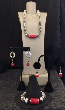 "A. Red Coral Focal Necklace, 15"" to 22"" $95. B. Earrings silver and red ball $28. C. Earrings red ball $28. D. Red Coral Focal Bracelet $59."