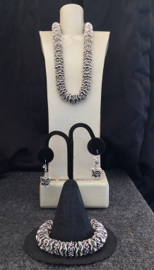 "A. Chunky Silver Necklace, 15"" to 22"" $95 B. Earrings $28 C. Chunky Silver Bracelet $59"