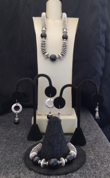 "A. Onyx Necklace, 15"" to 22"" $95 B. Earrings with silver $28 C. Earrings $28 D. Onyx Bracelet $59"