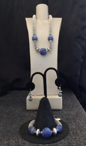 "A. Lapis Unpolished Necklace, 15"" to 22"" $95 B. Ear rings unpolished lapis $28 C. Lapis Unpolished Bracelet $59"