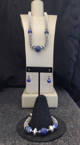 "A. Lapis Polished Necklace, 15"" to 22"" $95 B. Ear rings polished Lapis $28 C. Lapis Polished Bracelet $59"