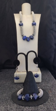 "A. Lapis Cut Polished Necklace, 15"" to 22"" $95 B. Ear rings Cut Polished Lapis $28 C. Lapis Cut Polished Bracelet $59"