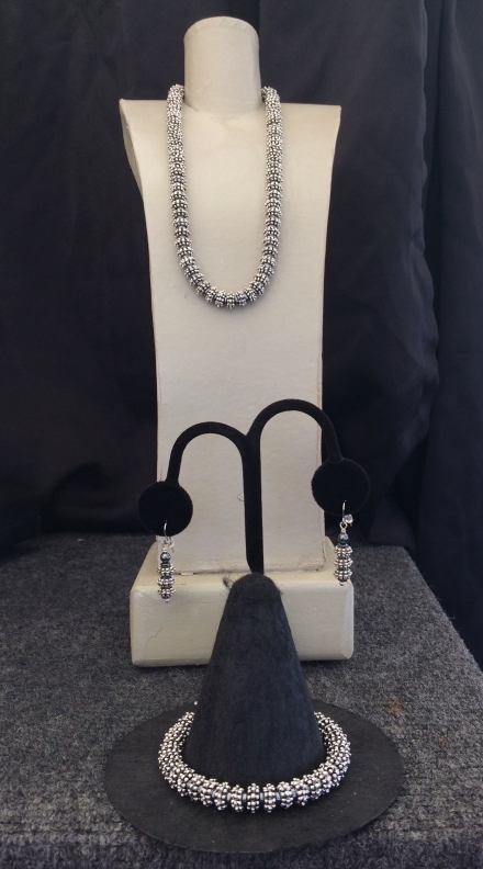 "A. Silver 8mm Necklace, Length 15"" to 22"" $95. B. Earrings $28. C. Silver 8mm Bracelet $59."