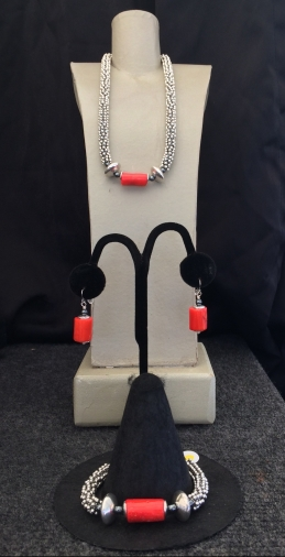 "A. Orange Coral Necklace, 15"" to 22"" $95. B. Orange Coral Bracelet $59."